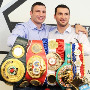 Ukrainian heavyweight boxers Wladimir Klitschko (R) and his brother Vitali Klitschko (L) pose with title belts during a press conference in Moscow, on July 8, 2011.  Wladimir and his fellow heavyweight champion elder brother, Vitali, arrived on July 8 in Moscow shortly after Wladimir's victory over Britain's Haye meaning the family now holds all four of the major world titles in professional heavyweight boxing. AFP PHOTO / NATALIA KOLESNIKOVA (Photo credit should read NATALIA KOLESNIKOVA/AFP/Getty Images)