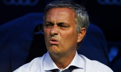 Real Madrid's coach Jose Mourinho from Portugal reacts during a Spanish La Liga soccer match against Valencia at the Santiago Bernabeu stadium in Madrid, Spain, Sunday, Aug. 19, 2012. (AP Photo/Andres Kudacki)