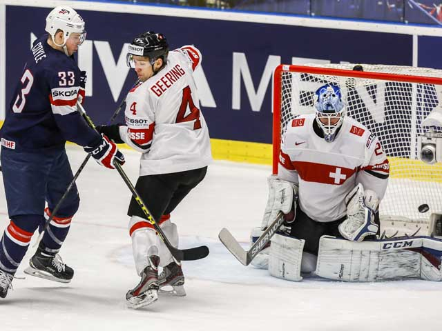 OSTRAVA, CZECH REPUBLIC - MAY 14:  Charlie Coyle (L) of USA scores over Reto Berra (R), goalkeeper of Switzerland, during the IIHF World Championship quaterfinal match between USA and Switzerland at CEZ Arena on May 14, 2015 in Ostrava, Czech Republic.  (Photo by Matej Divizna/Getty Images)