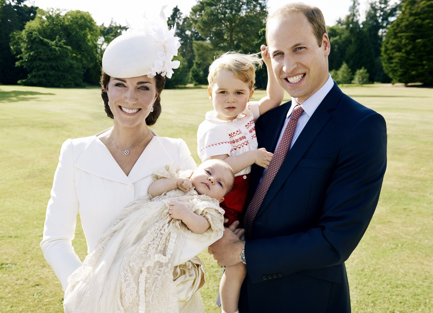 KING'S LYNN, ENGLAND - JULY 05: (EDITORIAL USE ONLY) In this handout image supplied by Mario Testino/ Art Partner, Catherine, Duchess of Cambridge, Prince William, Duke of Cambridge and their children Princess Charlotte of Cambridge and Prince George of Cambridge pose for a photo after the christening of Princess Charlotte of Cambridge at the Sandringham Estate on July 5, 2015 in King's Lynn, England. (Photo by Mario Testino/ Art Partner via Getty Images) ***Terms of release, which must be included and passed-on to anyone to whom this image is supplied: USE AFTER 10/10/2015 must be cleared by Art Partner. This photograph is for editorial use only. NO commercial use. NO use in calendars, books or supplements. Use on a cover, or for any other purpose, will require approval from Art Partner and the Kensington Palace Press Office. There is no charge for the supply, release or publication of this official photograph. This photograph must not be digitally enhanced, manipulated or modified and must be used substantially uncropped. Picture must be credited: copyright Mario Testino /Art Partner.***