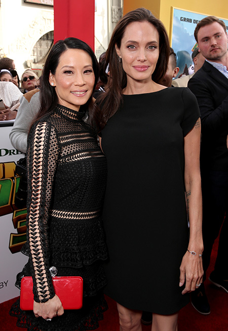 """HOLLYWOOD, CA - JANUARY 16: Actresses Lucy Liu (L) and Angelina Jolie attend the premiere of DreamWorks Animation and Twentieth Century Fox's """"Kung Fu Panda 3"""" at the TCL Chinese Theatre on January 16, 2016 in Hollywood, California. (Photo by Todd Williamson/Getty Images)"""