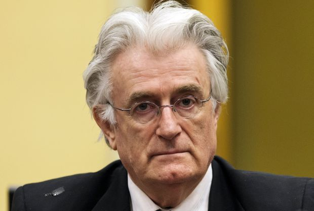 """Radovan Karadzic appears in court at the International Criminal Tribunal for Former Yugoslavia (ICTY) in The Hague, Netherlands in this July 11, 2013 file photo. On Thursday, 21 years after he was first indicted, the United Nations war crimes tribunal delivers its verdict on the man many Bosnians feared as the """"master of life and death"""" during the war of 1992-95.    REUTERS/Michael Kooren/Files     SEARCH """"WAR CRIMES KARADZIC"""" FOR ALL IMAGES?"""