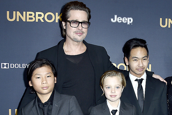 "HOLLYWOOD, CA - DECEMBER 15:  Actor Brad Pitt (C), (L-R) Pax Thien Jolie-Pitt, Shiloh Nouvel Jolie-Pitt,, Maddox Jolie-Pitt, Jane Pitt, and William Pitt attend the premiere of Universal Studios' ""Unbroken"" at TCL Chinese Theatre on December 15, 2014 in Hollywood, California.  (Photo by Frazer Harrison/Getty Images)"