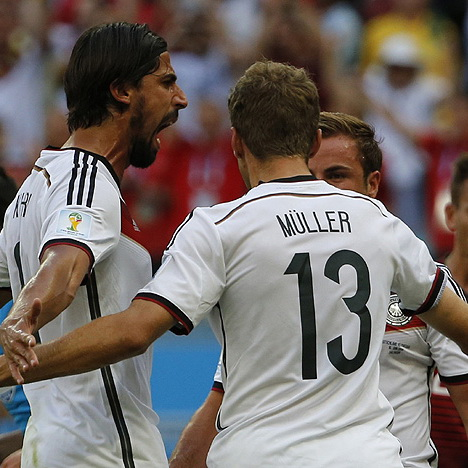 Germany's Mueller celebrates his goal against Portugal with teammates Khedira and Goetze during their 2014 World Cup Group G soccer match at the Fonte Nova arena in Salvador