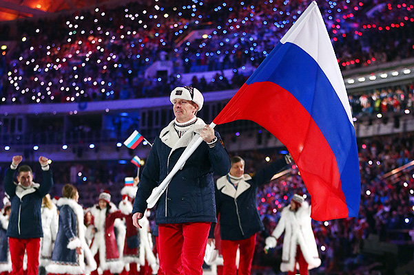 SOCHI, RUSSIA - FEBRUARY 07:  Bobsleigh racer Alexander Zubkov of the Russia Olympic team carries his country's flag during the Opening Ceremony of the Sochi 2014 Winter Olympics at Fisht Olympic Stadium on February 7, 2014 in Sochi, Russia.  (Photo by Ryan Pierse/Getty Images)
