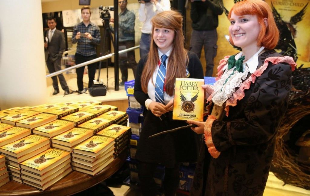 Competition winner Fran Plagge (R) is the first to receive a copy of the book of the play of Harry Potter and the Cursed Child parts One and Two at a bookstore in London, Britain July 31, 2016. REUTERS/Neil Hall