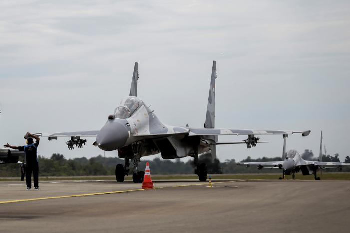 Indonesian Air Force Sukhoi fighter jets land after training for an upcoming military exercise at Hang Nadim Airport, Batam, Riau Islands, Indonesia