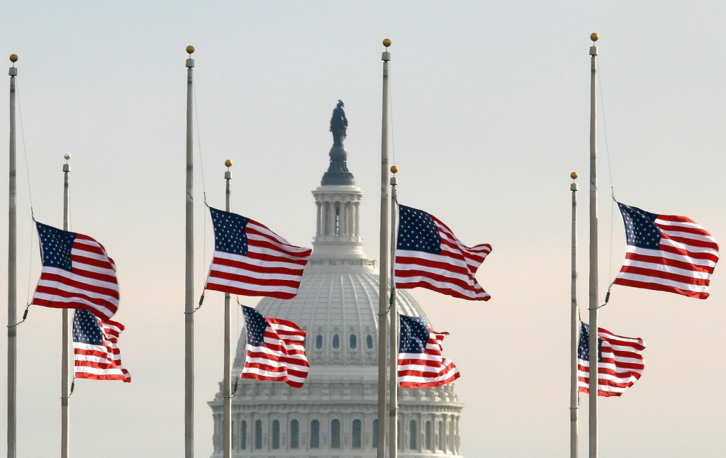 WASHINGTON - JANUARY 10: American flags fly at half staff on the National Mall in front of the U.S. Capitol in memory of the victims of Saturday's mass shooting in Arizona, January 10, 2011 in Washington, DC. U.S. President Barack Obama called on the nation to observe a moment of silence today at 11:00am.   Win McNamee/Getty Images/AFP== FOR NEWSPAPERS, INTERNET, TELCOS & TELEVISION USE ONLY ==