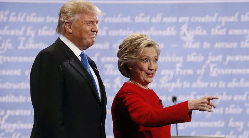 Republican U.S. presidential nominee Donald Trump and Democratic U.S. presidential nominee Hillary Clinton look on at the start of their first presidential debate at Hofstra University in Hempstead