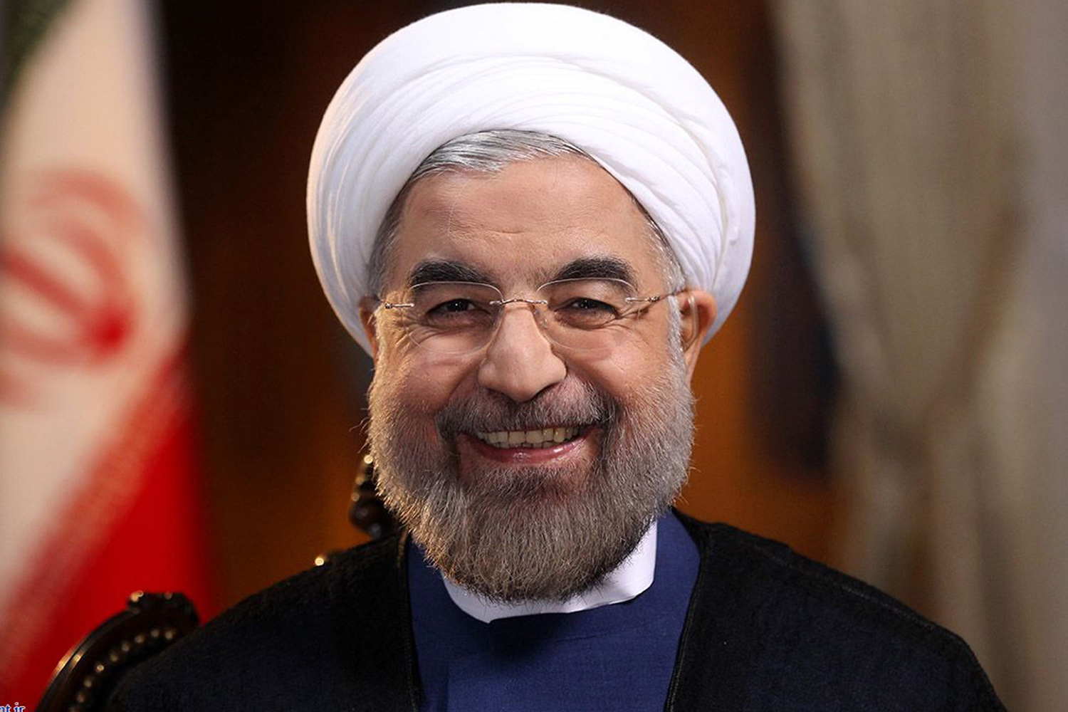 Iranian President Hassan Rouhani smiles during an interview with Ann Curry from the U.S. television network NBC in Tehran, in this picture taken September 18, 2013, and provided by the Iranian Presidency. Rouhani said in the television interview with NBC News on Wednesday that his government would never develop nuclear weapons and that he had