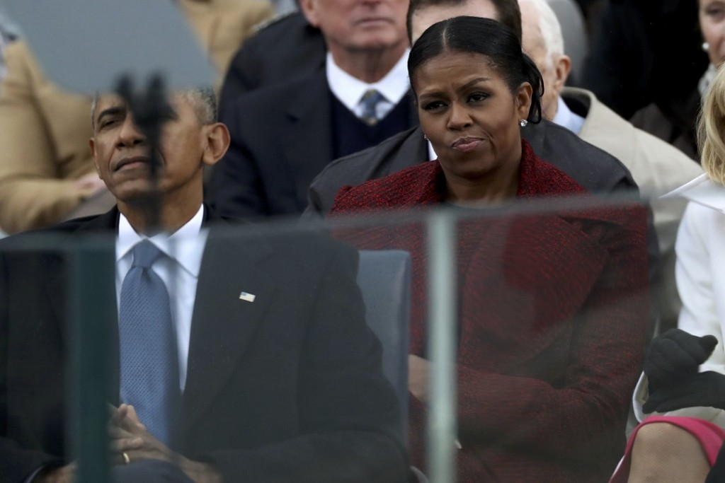 Outgoing U.S. first lady Michelle Obama listens to incoming President Donald Trump speak during inauguration ceremonies at the U.S. Capitol in Washington