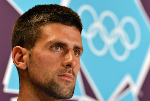 Serbian tennis player Novak Djokovic is pictured during a press conference along with countrymates athletes at the Main Press Center in London on July 26, 2012 on the eve of the official opening of the London 2012 Olympic Games. AFP Photo / Saeed Khan        (Photo credit should read SAEED KHAN/AFP/GettyImages)