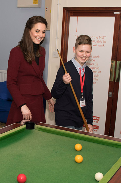 PONTYPOOL, WALES - FEBRUARY 22:  Catherine, Duchess of Cambridge plays pool with Craig Davis, 15, during her visit to MIST, a child and adolescent mental health project, part of Action for Children which supports vulnerable families in Wales and across the UK on February 22, 2017 in Pontypool, United Kingdom.  (Photo by Paul Edwards - WPA Pool/Getty Images)