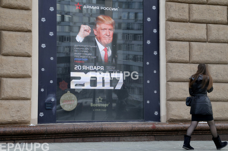 Russian Army Store decorated an advertising board shows a portrait of US President-elect Donald Trump in Moscow