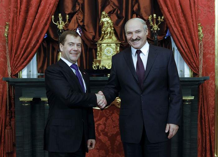 Russia's President Medvedev shakes hands with Belarus' President Lukashenko during their meeting before a summit in Moscow's Kremlin