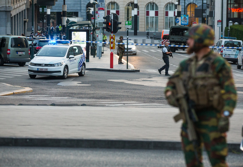 epa06039847 An armed soldier stands guard as police activies goes on outside of the Brussels Central Station after a neutralized terrorist attack attempt, in Brussels, Belgium, 20 June 2017. According to Belgian media, police shot a suspect wearing an explosive belt at the Brussels Central Station. Belgian police also confirmed there was a small explosion in the Brussels Central Station, but said there are not much damage done and situation is under control. The cause of the explosion is unknown.  EPA/STEPHANIE LECOCQ